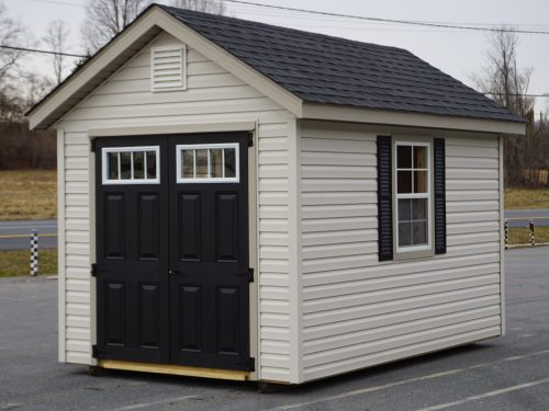 tan vinyl classic cottage with black trim