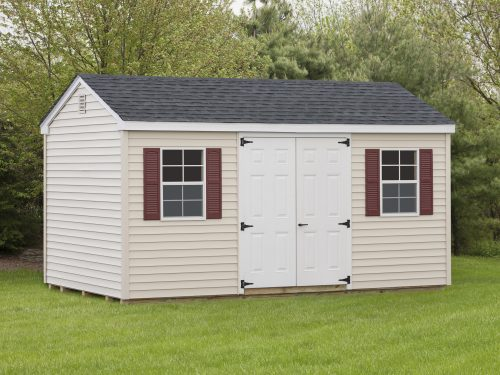 tan cottage shed with red shutters