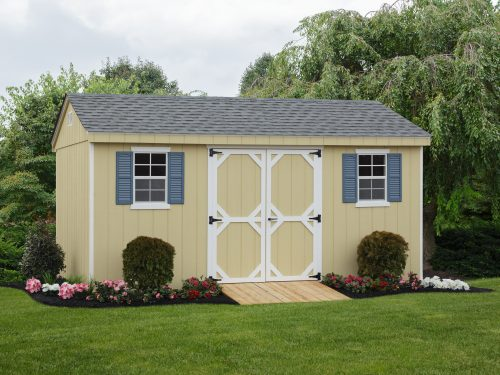 yellow cottage shed with blue shuters