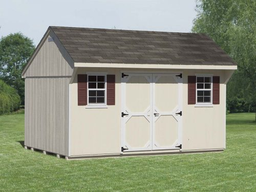 white classic quaker shed with green trim