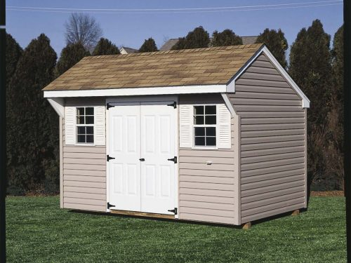 tan classic quaker shed with teal trim