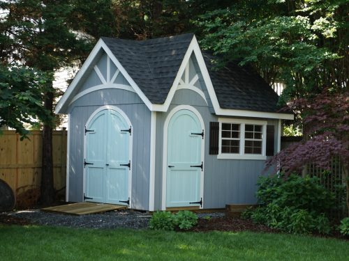 unique shaped cottage shed in backyard