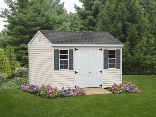white vinyl cape shed and blue shutters