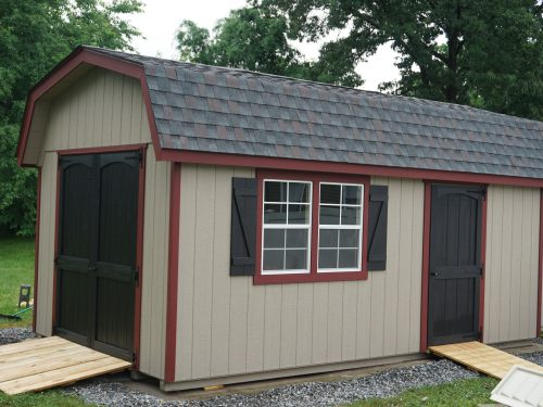 red, black, and tan classic dutch barn