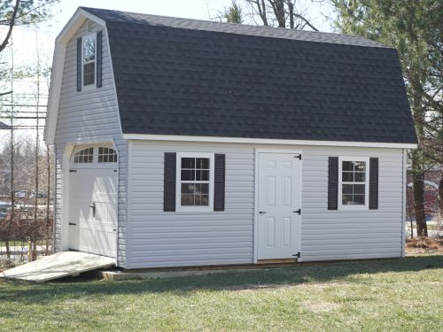 two story dutch barn with vinyl siding