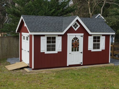 red and white classic a-frame dormer shed