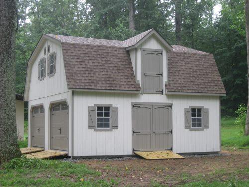 light gray two story dutch barn
